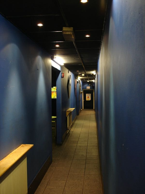 When you enter the club, there's long and narrow corridor painted in blue colour. Still not a sign of a bar.