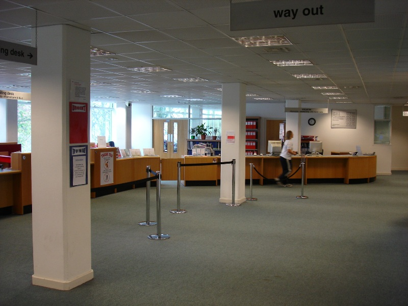 "We've just entered the library, in front of us, there's a main lending desk. Let's go deeper to the ""silent area""..."