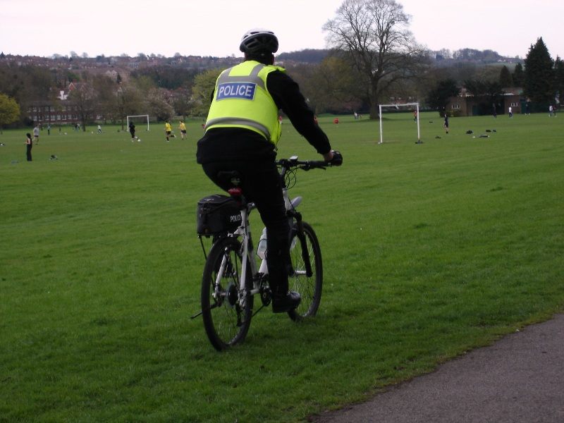 Oops, what's this? A policeman on a bicycle? What an unusual thing! Well, it might be usual here, who knows...